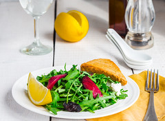 light green salad with arugula, beets, goat cheese…