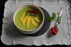 Green smoothie bowl with mango and raspberry II