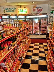 liquor store(0.0), supermarket(1.0), whole food(1.0), convenience store(1.0), building(1.0), food(1.0), marketplace(1.0), convenience food(1.0), aisle(1.0), grocery store(1.0), delicatessen(1.0), retail-store(1.0),