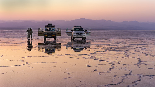 africa travel pink sunset people mountains reflection zeiss landscape purple 4x4 unique empty sony horizon extreme transport adventure exotic 55mm journey toyota land remote ethiopia alpha suv landrover saline saltflats cruiser a7 harsh eastafrica geologic greatriftvalley danakildepression sonnartfe55mmf18zalens