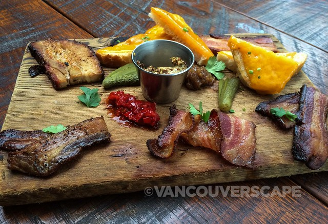 Bacon board: Rear: smoked pork belly, bacon confit, cheesy bread; Front: Pepper bacon, Jalapeño bacon, cherrywood smoked bacon