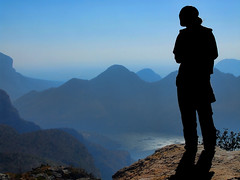 silhouette of young girl against a stunning view