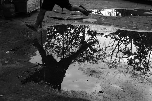 life street city bw water 35mm puddle photography jump philippines streetphotography human sur activity region bicol irigacity camarines iriga