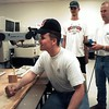 Throwback Thursday: July 1996, Texas State Technical College students Virgil Minor of Overton, Ben Cannon and Matt Lyles of Gilmer play with a computerized robotic arm during lunch break. @news.journal