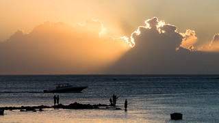 Image of Mont Choisy Beach near Grand Baie. sunset water clouds lights boat indianocean fisher mauritius nuages bateau pêcheur océanindien monchoisy