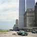 More Lower Manhattan adventures in the good old days. The swampy fields of future Battery Park City, a guy from New Jersey takes a snooze, The World Trade Center hovers and all is right with the world. New York. August 1976 by wavz13