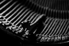 plucked string instruments(0.0), office equipment(0.0), guitar(0.0), typewriter(1.0), monochrome photography(1.0), close-up(1.0), monochrome(1.0), black-and-white(1.0), black(1.0),