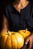 Pumpkins in female hands.