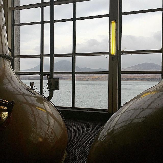 The #stills at #caoliladistillery overlooking #papsofjura #caolila #jura #isleofjura #islay #islaywhisky #scotchmaltwhisky #singlemaltscotchwhisky