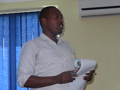 Tanga assistant Regional Administrative Secretary making closing remarks during the Maziwa Zaidi Review and Planning Meeting March 30-1 April 2015 in Dar es Salaam, Tanzania. photo: Mercy Becon