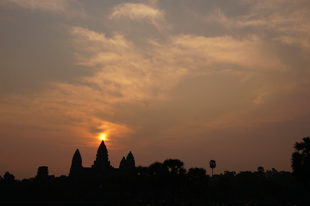 Sun above the center spire of Angkor Wat