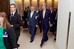 U.S. Secretary of State John Kerry walks with Iranian Foreign Minister Javad Zarif as they arrive at a meeting room in Geneva, Switzerland, on May 30, 2015, for the latest round in the P5+1 negotiations about the future of Iran's nuclear program. [State Department Photo/ Public Domain]