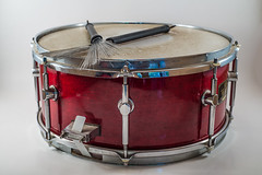 Horizontal Red Wooden snare drum and Jazz brushes isolated on a white background. Jazz Music.