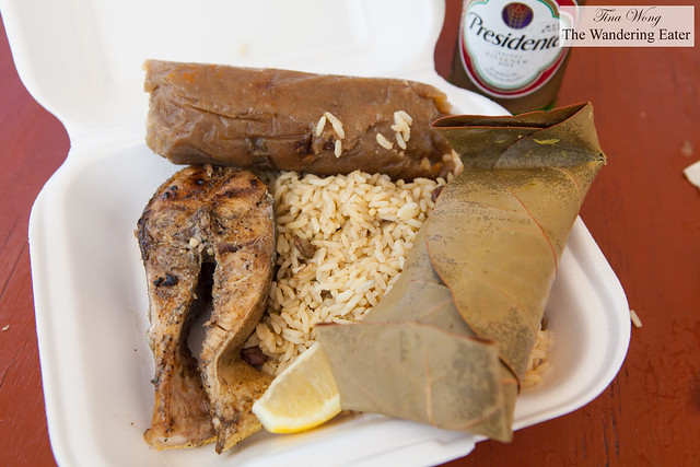 My lunch of grilled Wahoo fish, rice and peas, corn and apple pudding, and sweet potato pudding wrapped in grape leaves