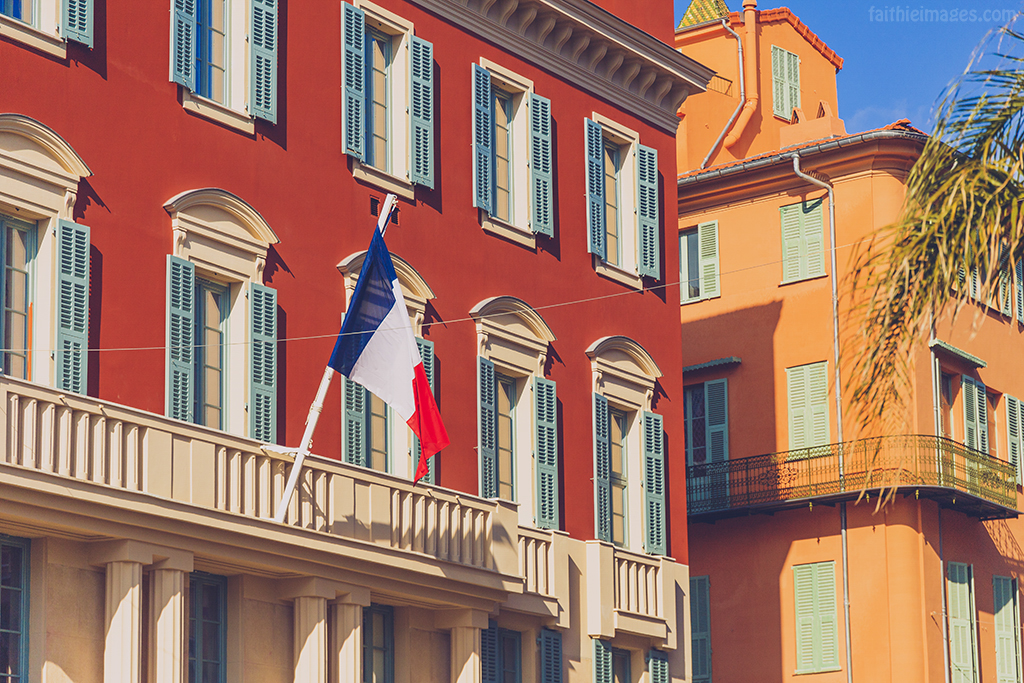 French flag waving off the Hotel de Ville in Nice