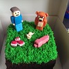 A minecraft based birthday cake for the youngest.   #minecraft #cake #birthday #stampylongnose #pigs #tnt #mouse #grass #blocks #game #gaming #orange #choc