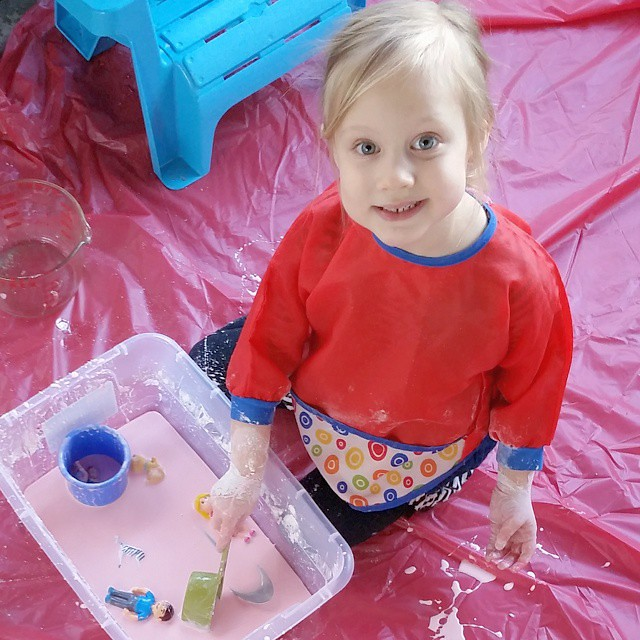 For this week's activity, we made goop/oobleck! Lily was fascinated by how it felt almost like playdoh, but dripped out of her hands like a liquid! Such a cheap, easy activity, but I highly recommend a plastic tablecloth!!! I loved this stuff when I was i