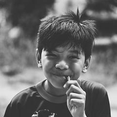 Malaysian Boy. He's enjoying his sweet candy so much.