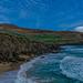 A Dingle Peninsula beach under a blue sky by dinglepeninsula