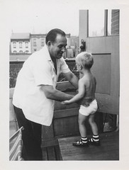 Man picks up a little boy in his undies