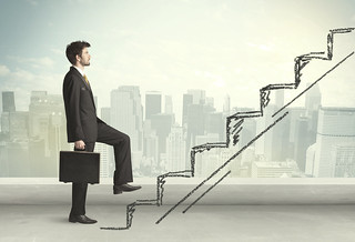 Businessman going up the stairs - Flexible work: It's not just staff who benefit