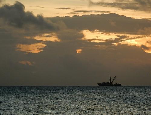 funafuti tuvalu sunset sky dramatic stormy horizon fishingboat silhouette