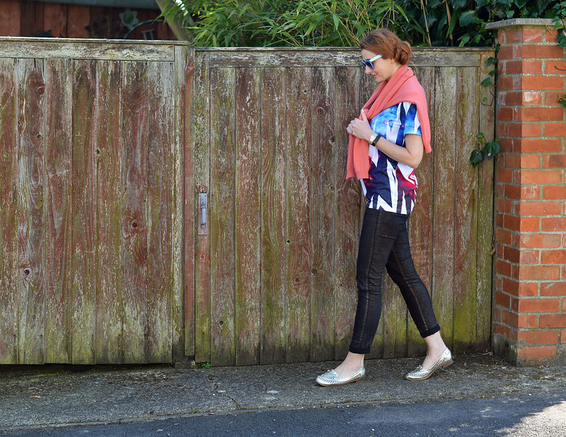 Graphic t-shirt, coral sweater, skinnies and metallic woven loafers