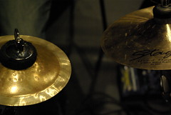 percussion(0.0), bell(0.0), drum(0.0), lighting(0.0), musical instrument(1.0), light(1.0), close-up(1.0), cymbal(1.0),