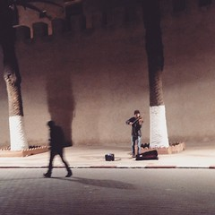 #Traveling with his #music.          I'm sure this wasn't a normal scene in the #streets of #Essaouira. I was in my hotel room when I hear a classical music playing. I thought the old hotel was hunting me but then I opened my window and saw this guy playi