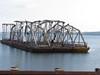 Bridge remnants loaded on barges