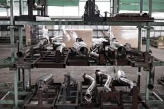 art(0.0), mass production(0.0), machine(0.0), sport venue(0.0), gym(0.0), room(1.0), industry(1.0),
