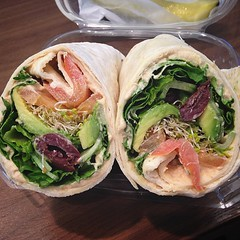 Hummus Wrap with sprouts, tomatoes, cucumbers, lettuce, olives and avocado (sub'ed for feta) from Chesapeake Plaza Deli. An excellent option for a working lunch! #vegan #veganinsd #vegansofig #veganfoodshare #sdfoodie #sdfooddiaries #whatveganseat #p2tv #