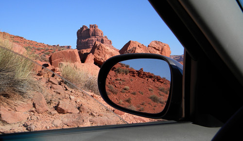 Car mirror reflecting the Valley of Gods in the American Southwest