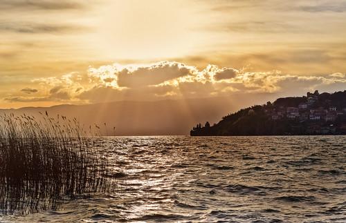 light sunset sun sunlight lake silhouette clouds landscape macedonia ohrid lakeshore sunrays cloudscape lakescape lakeohrid ohridlake cloudsscape
