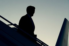 U.S. Secretary of State John Kerry is seen in silhouette as he deplanes against an evening sky after arriving in Geneva, Switzerland, on May 29, 2015, for the latest round of talks with Iranian leaders about the future of their nuclear program. [State Department Photo/ Public Domain]