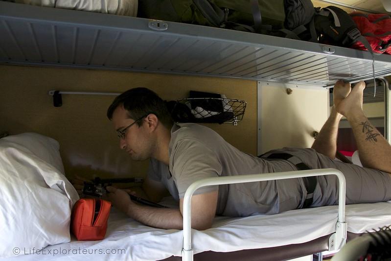 Antoine reading on his berth