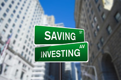 Saving and Investing Street Sign On Wall Street