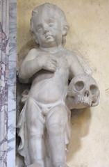 grieving cherub with a skull