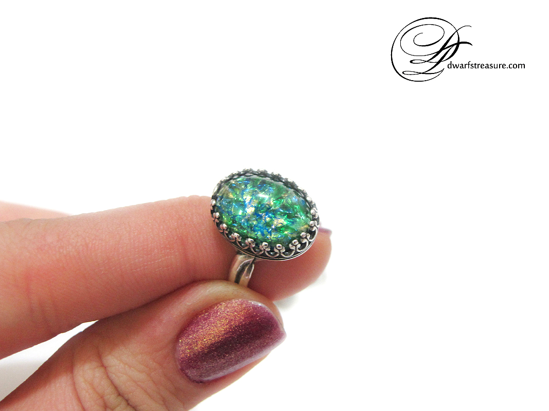 Beautiful adjustable rings with green opal oval glass cabochons.