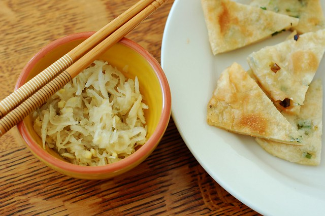 Pickled daikon radish threads with green onion pancakes by Eve Fox, The Garden of Eating, copyright 2015