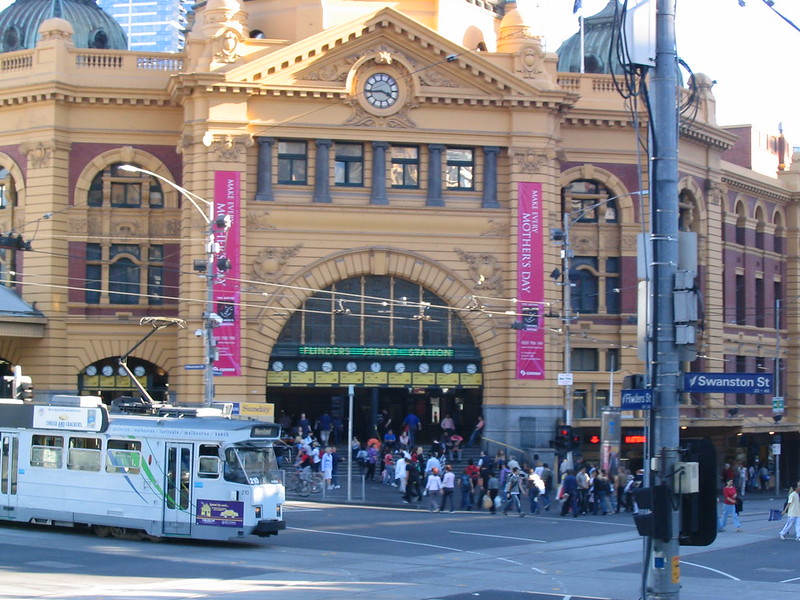 Tram passes Flinders Street station, April 2005