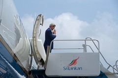U.S. Secretary of State John Kerry makes the namaste gesture on May 3, 2015, in Colombo, Sri Lanka, as he prepares to board his airplane and depart the island-nation after the first official visit by someone in his office in 43 years. [State Department Photo/Public Domain]