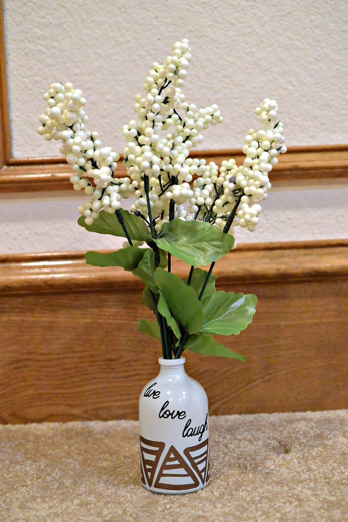 Vinyl embellishments on a bud vase makes a simple DIY project.