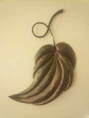 "High relief repousé leaf 14"" x 20"" x 2"". Mild steel with copper patina."