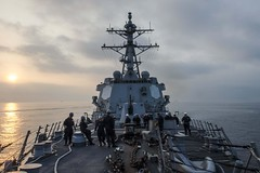 Sailors aboard USS Mustin (DDG 89) prepare to moor the ship in Hong Kong. (U.S. Navy/MCSN David Flewellyn)