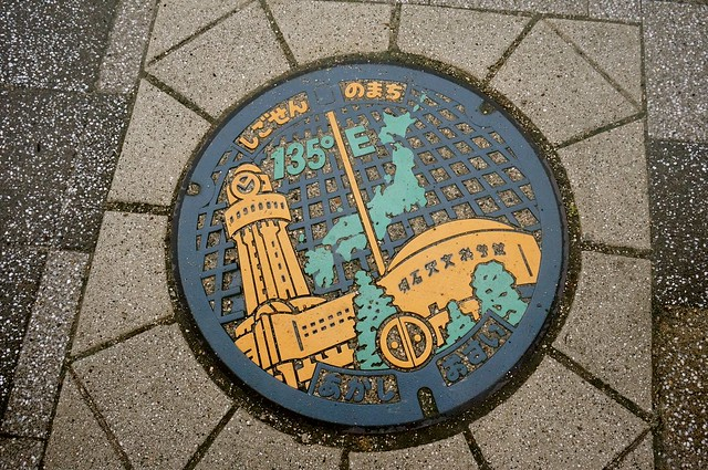 Manhole by the 135 Meridian East in Akashi