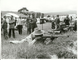 National Rifle Shooting Championship's at Trentham, N Z Representive [Representative] T W Penrose reloads on the mound
