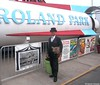 Dr. Takeshi Yamada and Seara (Coney Island Sea Rabbit) and the Astroland Park space rocket in Coney Island of Brooklyn, NY on August 8, 2015.  20150808 100_9122=4030pC-1