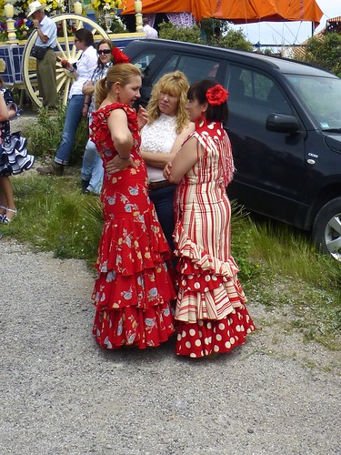 Romeria in Pruna: ladies in flamenco dress