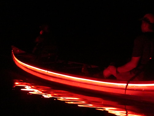 Red light canoe at night.